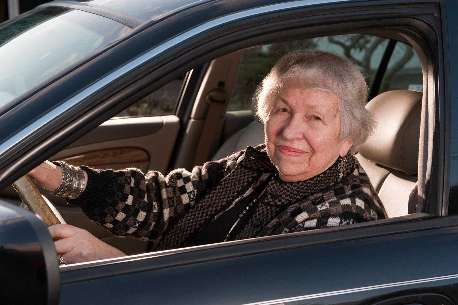 senior woman behind the wheel of car