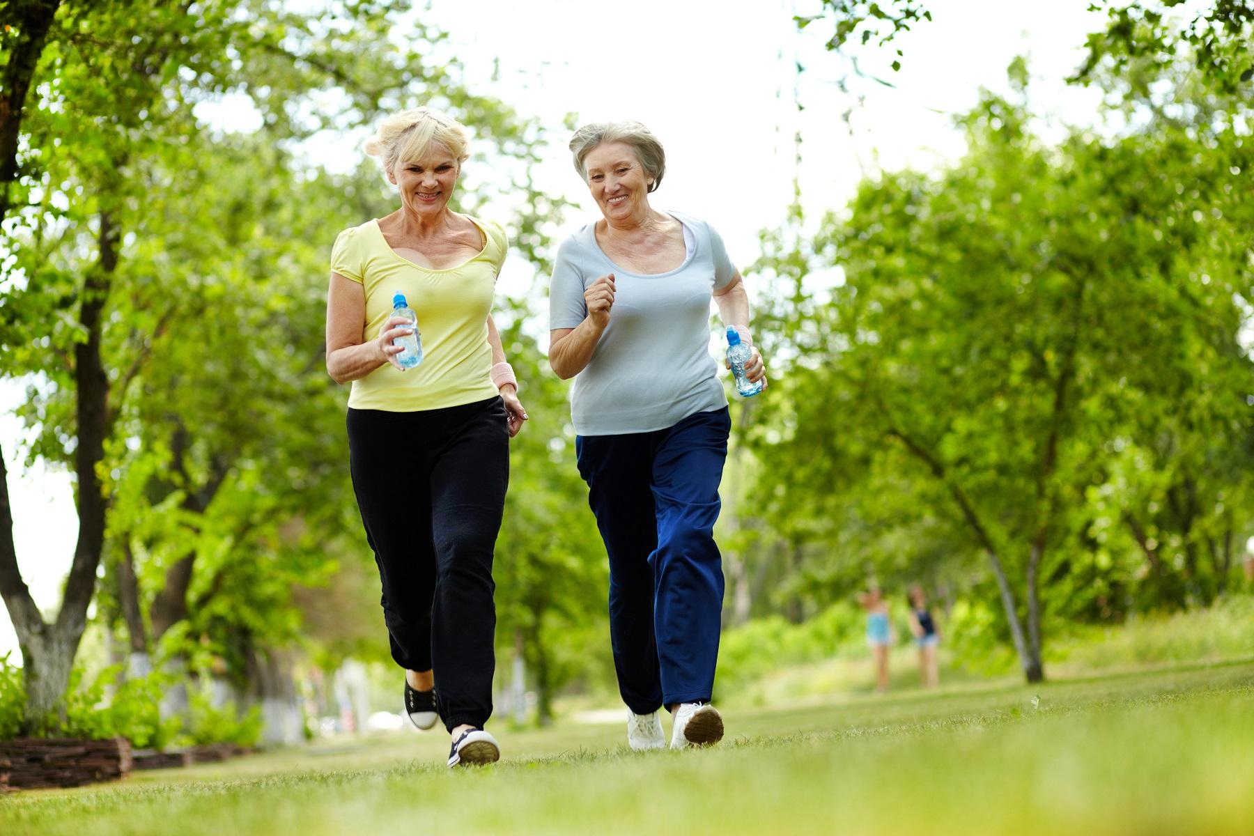 active senior women taking a powerwalk