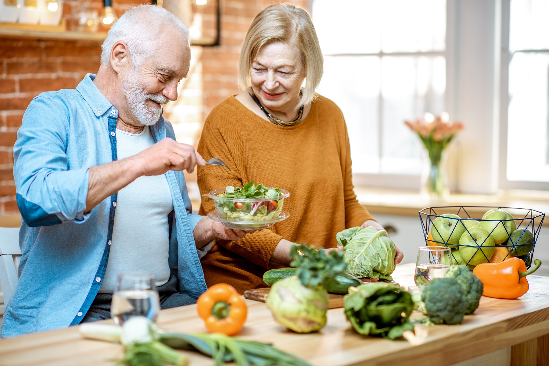 Seniors couple making nutritional meal, good for brain health