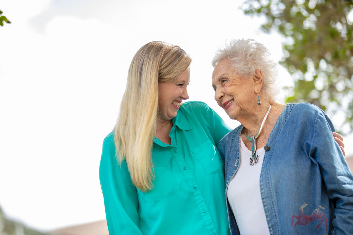 Senior woman laughing and smiling with her daughter