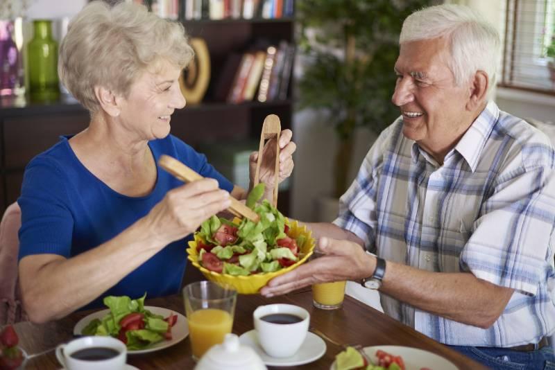 Senior couple enjoying a salad