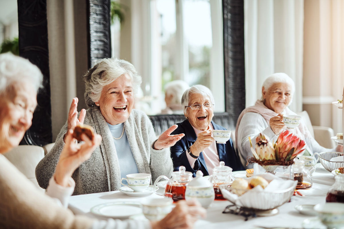 a group of senior women enjoying breakfast together