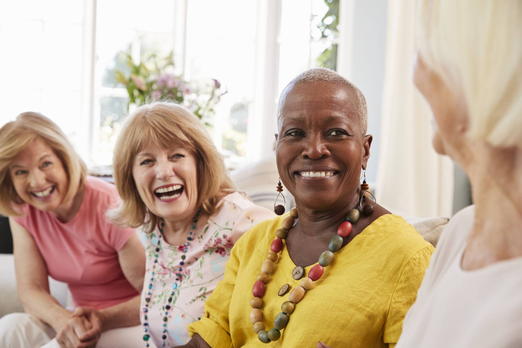 group of senior women socializing at their retirement community