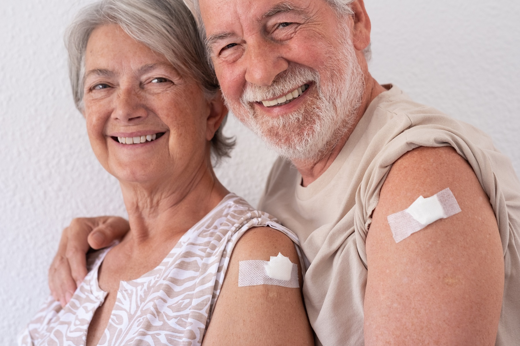 senior couple posing for picture after immunizations