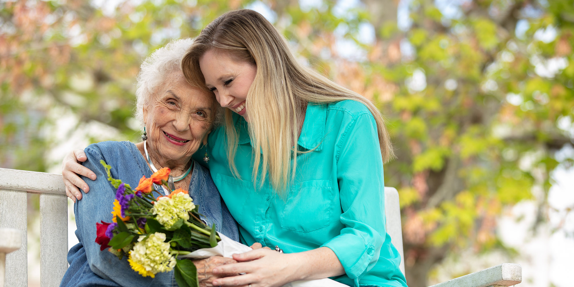Senior woman hugging her daughter while at her Brandon FL assisted living facility