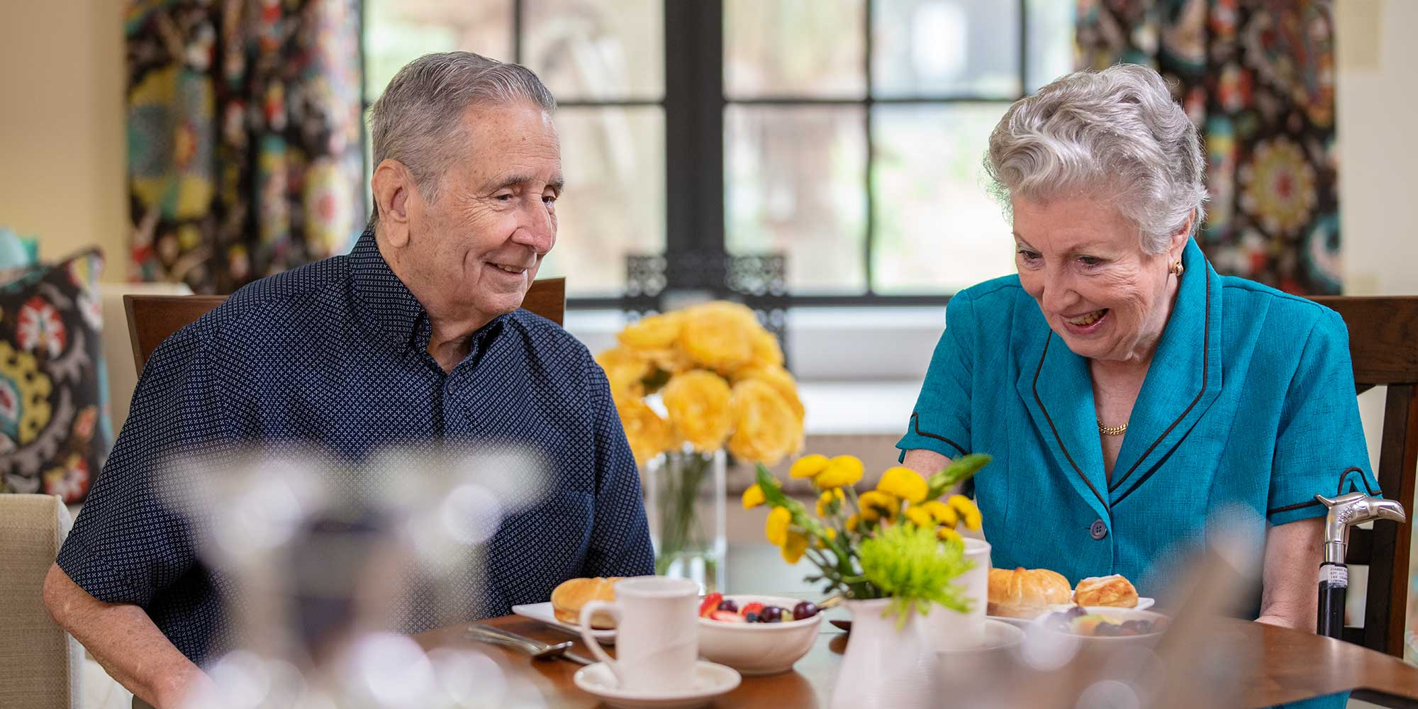 Elderly couple enjoying breakfast at their memory care facility in Venice FL