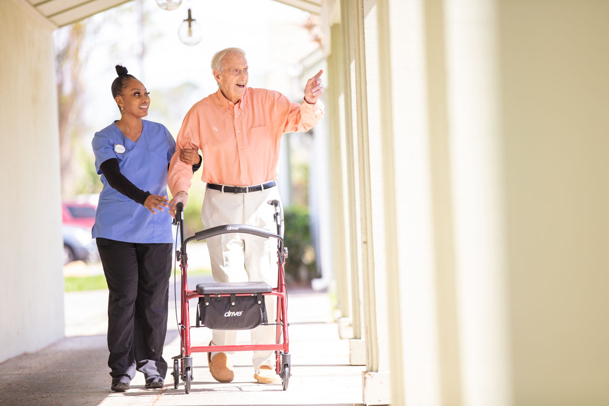 Elderly man going on a walk with this assisted living caregiver