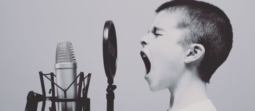 Echo-NHS-Healthcare-Young-Boy-Screaming-into-Microphone
