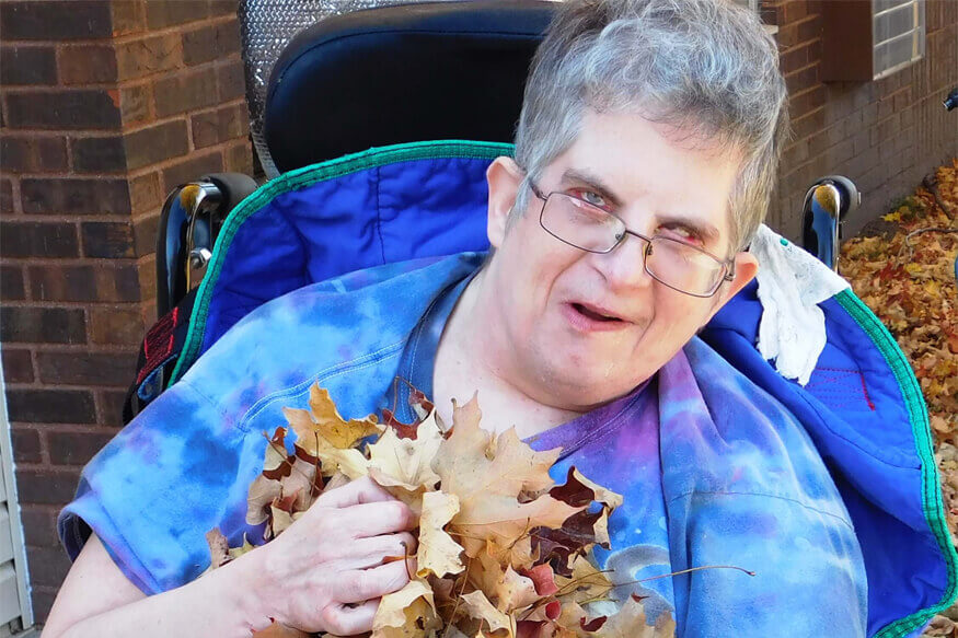 woman holding leaves
