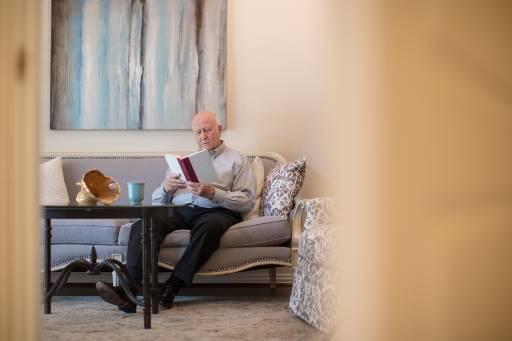Senior man sitting on his couch in his senior apartment