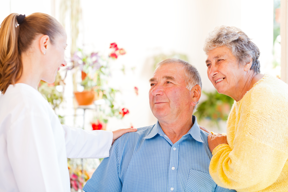 Senior couple talking with a doctor