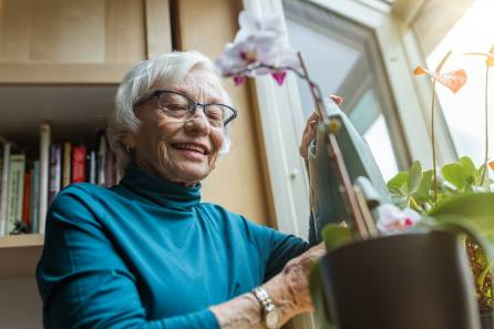 Senior woman taking care of her plant