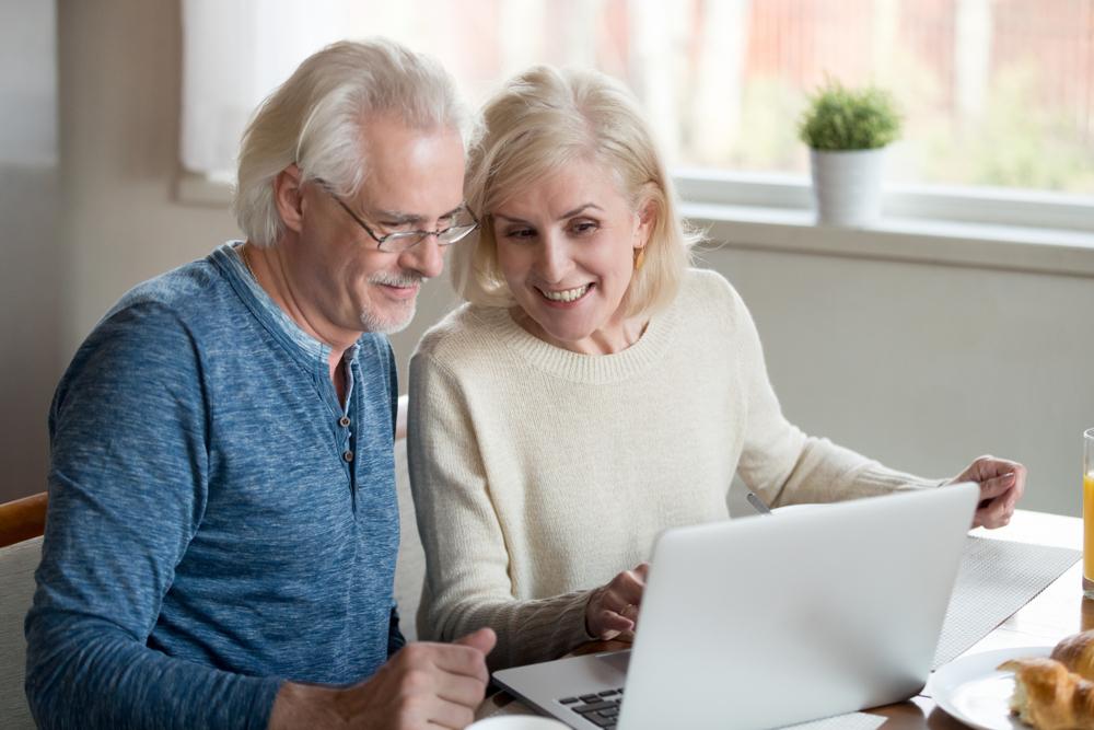 Two seniors looking at a computer