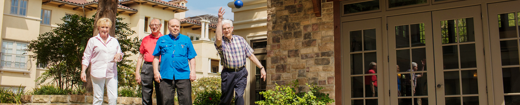 A group of seniors playing Bocce ball at Edgemere a senior living community in Texas