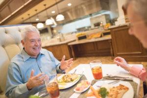 two senior men enjoying a meal