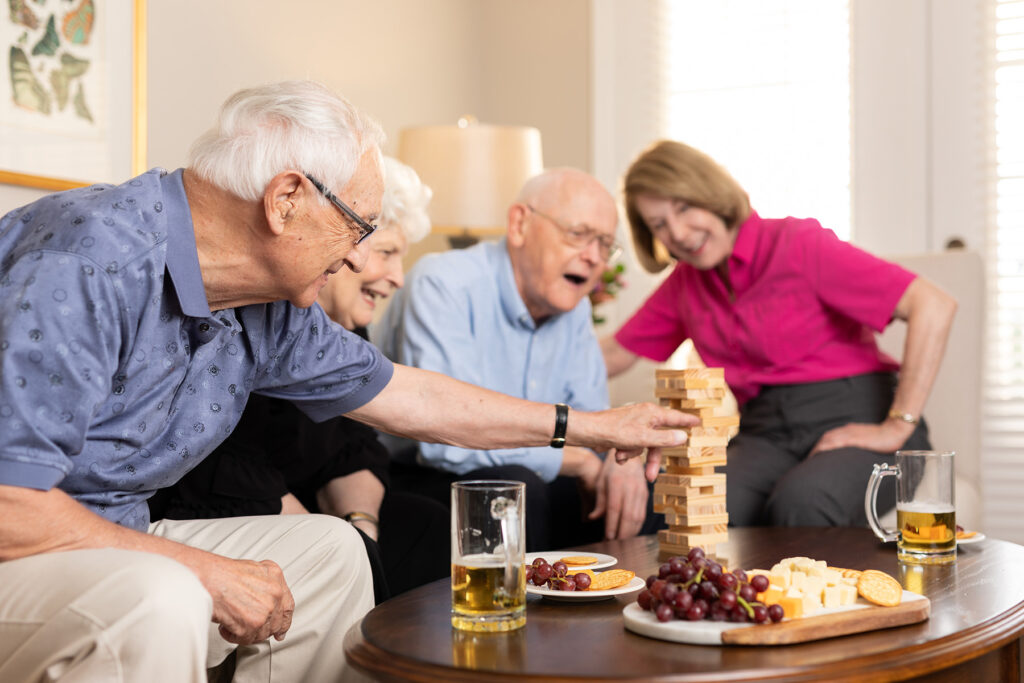 group of senior residents playing games and eating together