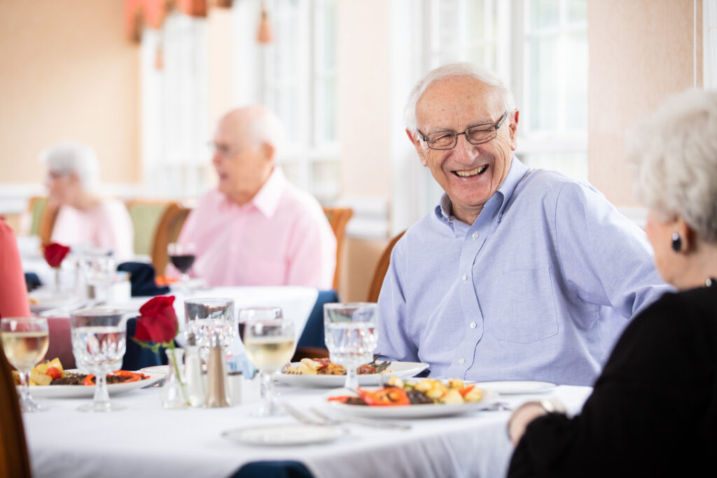 senior couple having lunch together at independent living community