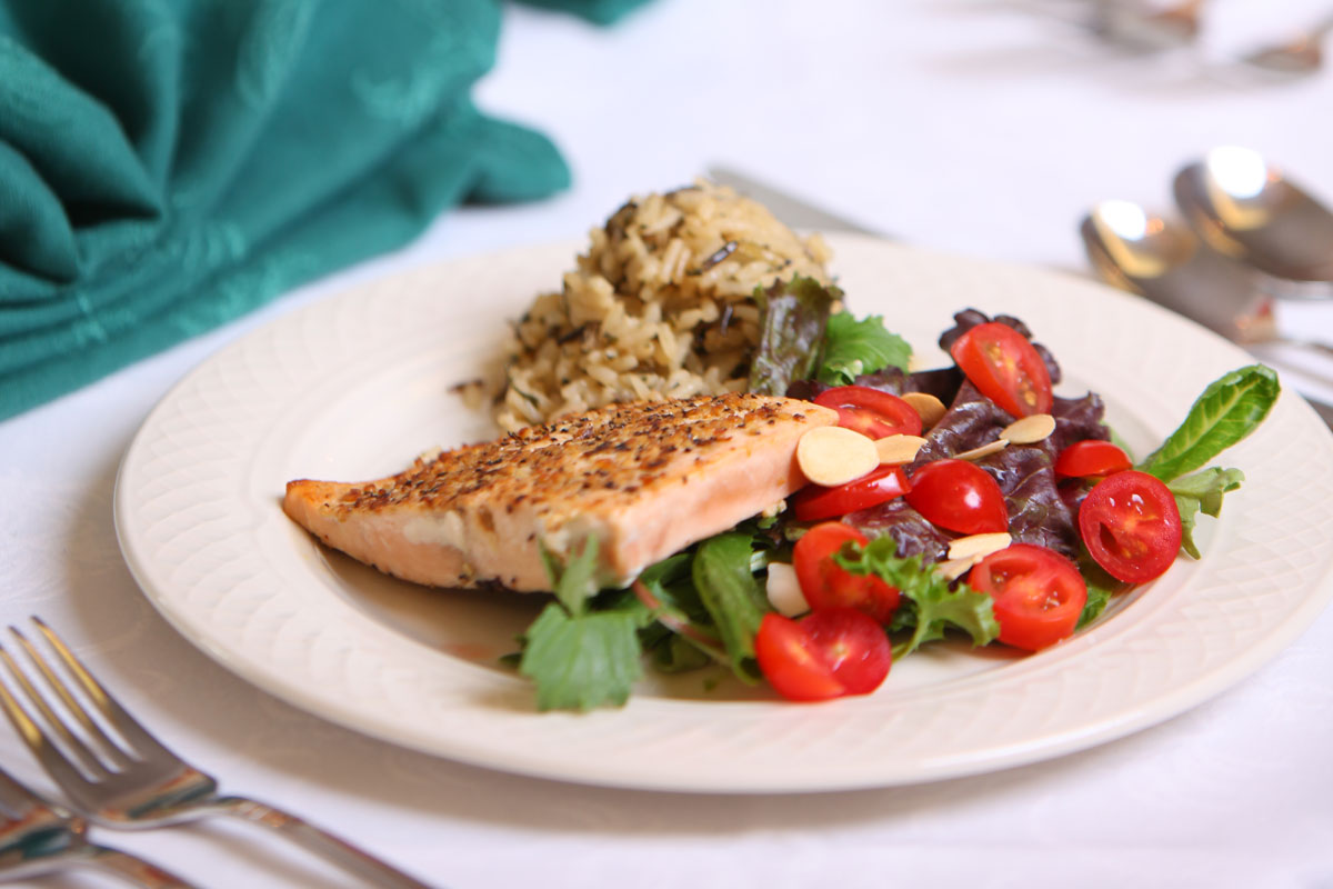 dinner plate with salmon, salad and rice