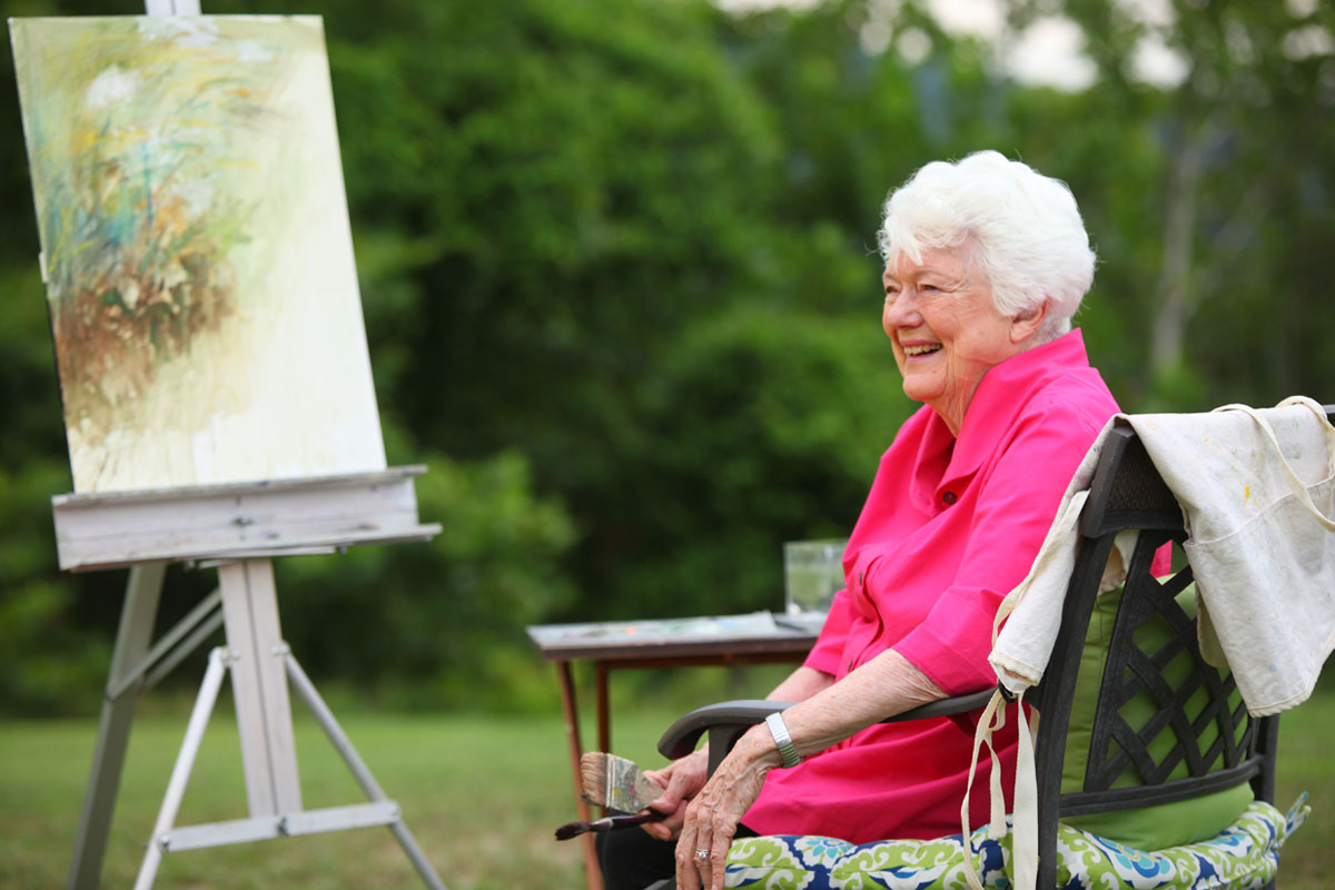 smiling woman at her painting