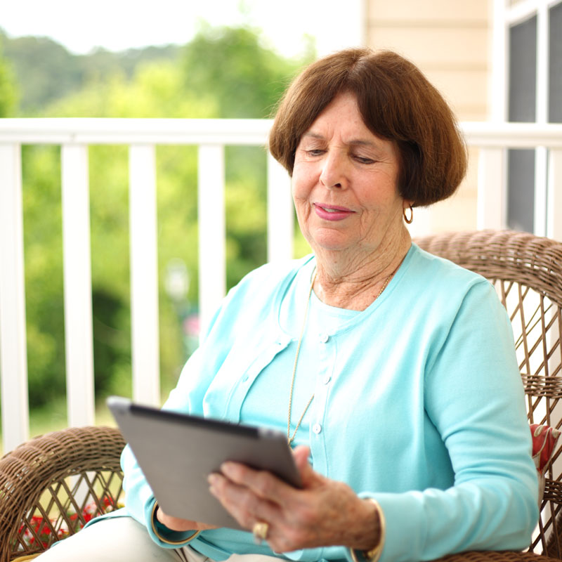 a woman searching her tablet