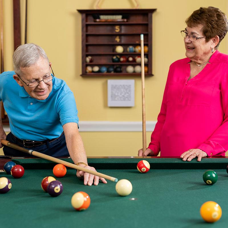 Seniors playing billiards