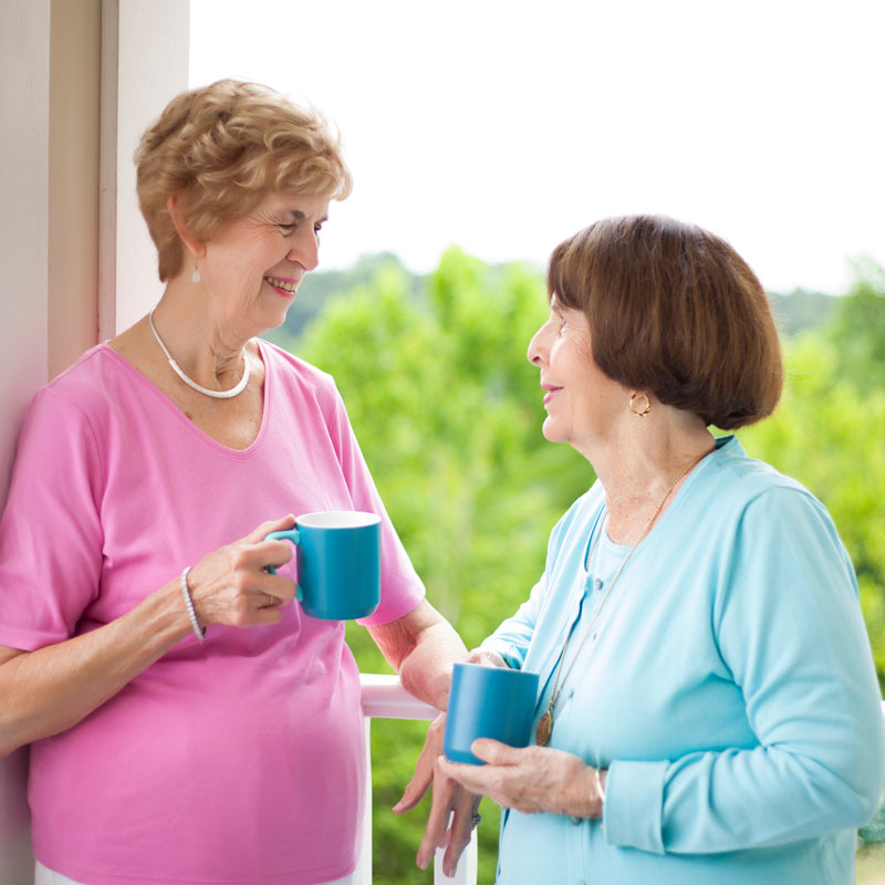 two women socializing at independent senior living community