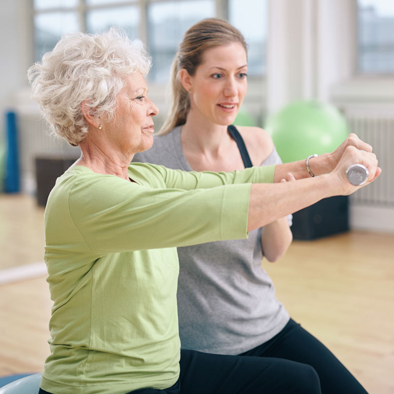 woman and personal trainer exercise