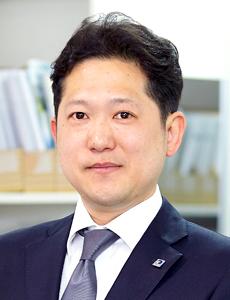 石田 賢治