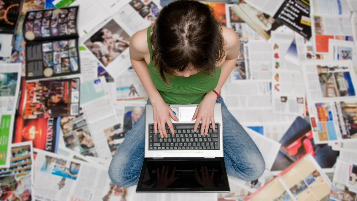 typing women with magazines