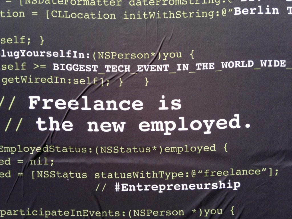 Image with web code and quote about freelancing