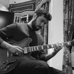 Ozzy Duzenli Guitarist in London