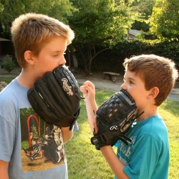 Cheryl Dumesnil's tween sons with their baseball mitts—ESME.com