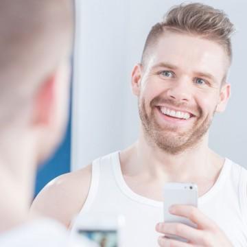 man doing a selfie in mirror- ESME.com
