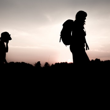 A single mom and her son hiking in front of a hazy backdrop—ESME.com