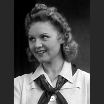 "Screen shot of June Storey from the 1940 film ""Rancho Grande""—ESME.com"