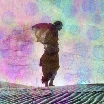 Abstract female figure in desert dune, illustrating moms who have lost children—ESME.com