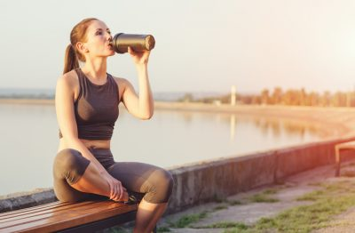 Woman Drinking Protein