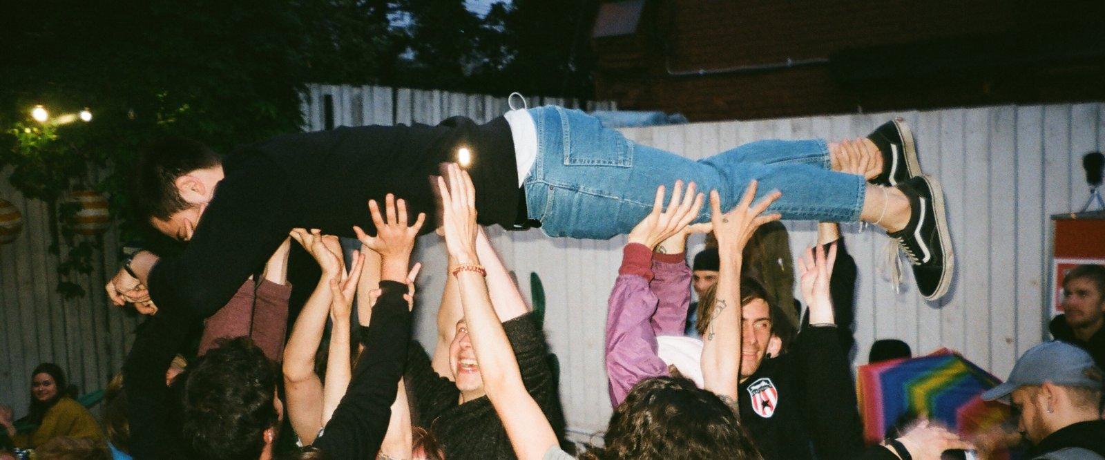 people-lifting-man-at-night-2601200.jpg