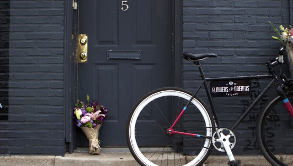 Ashley-Marie, a bike courier for Flowers for Dreams, on her route delivering bouquets.