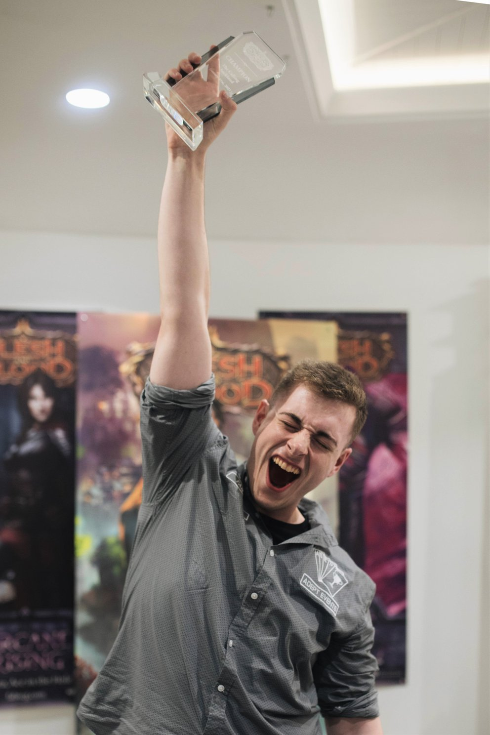 Jacob Pearson, Champion of The Calling Auckland 2021, holds his trophy aloft, cheering