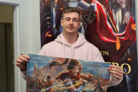 Cerberus Games Skirmish winner Jacob Pearson holding his prize playmat