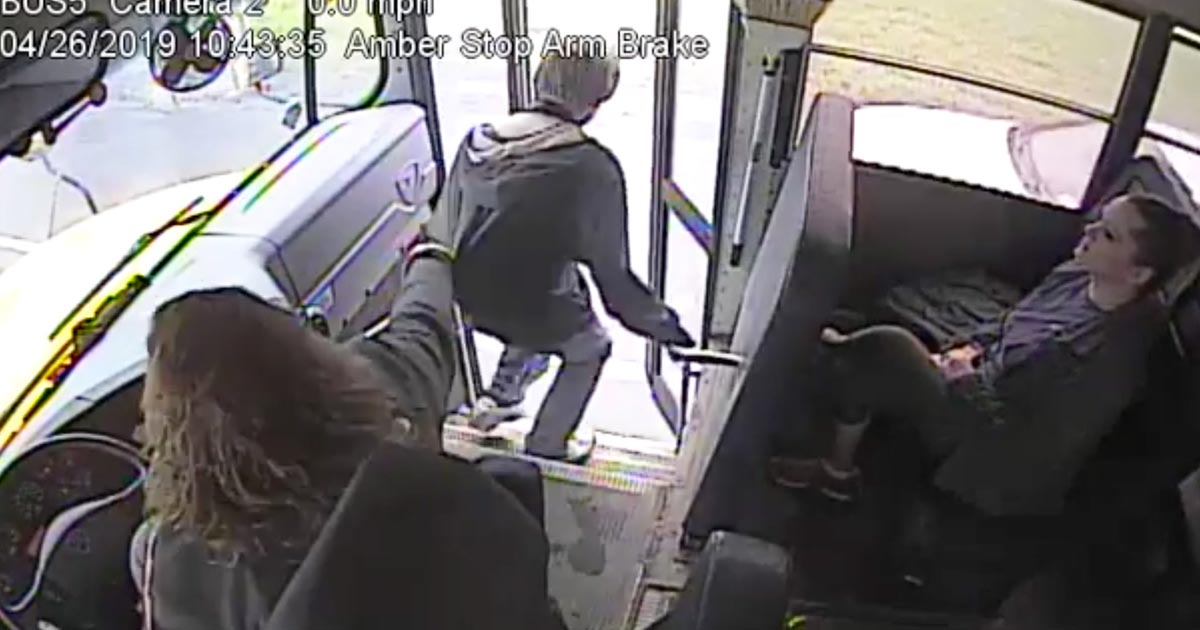 bus driver stops boy from hitting car
