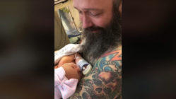new-dad-cries-holding-baby