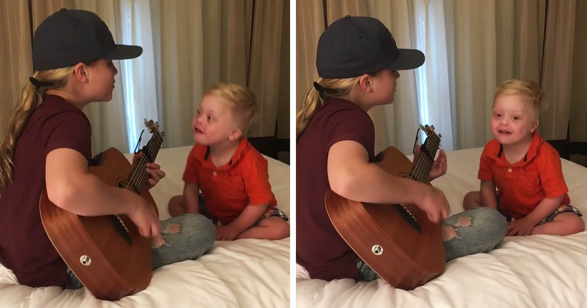 down-syndrome-boy-listens-sister-music