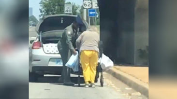 Airman-helps-elderly-woman