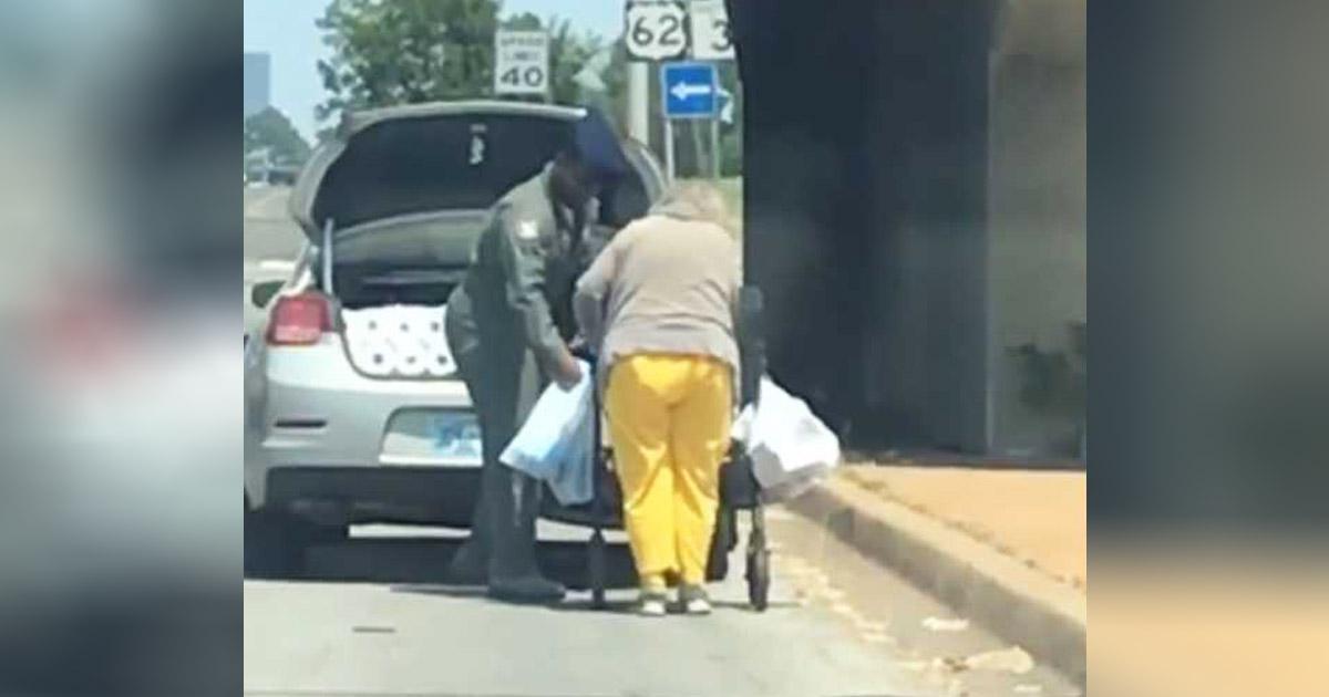 Airman-helps-elderly-woman
