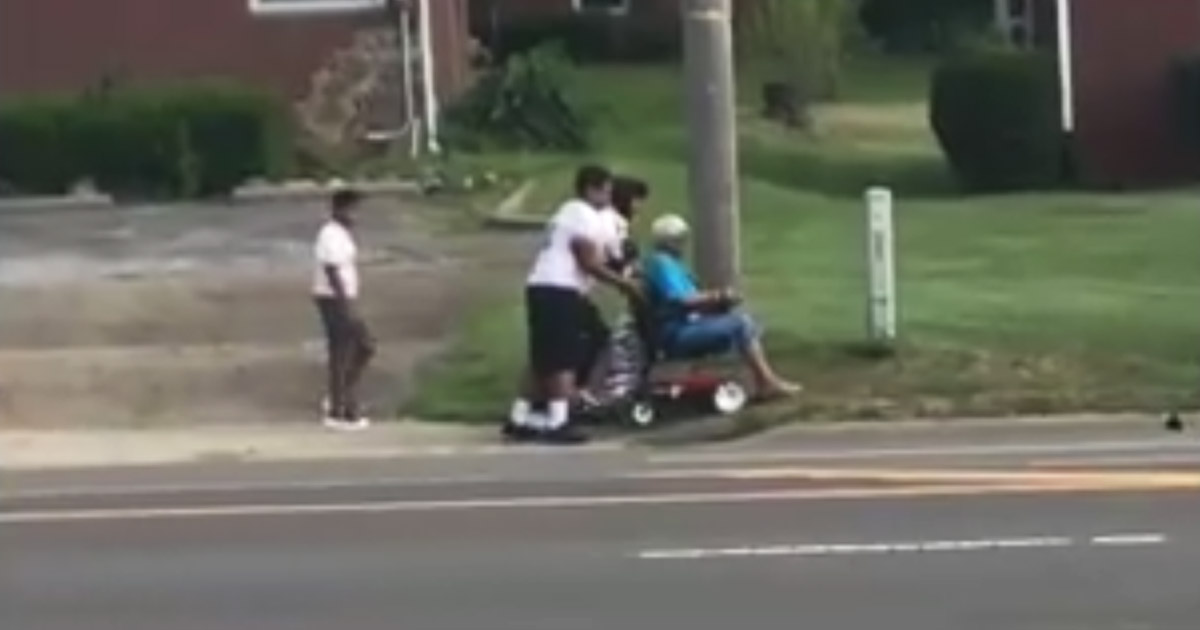 Middle-School-Football-Players-Helps-Wheelchair-bound-Elderly-Woman-main