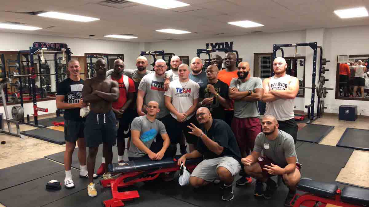 football-players-shave-heads-to-support-coach-battling-cancer