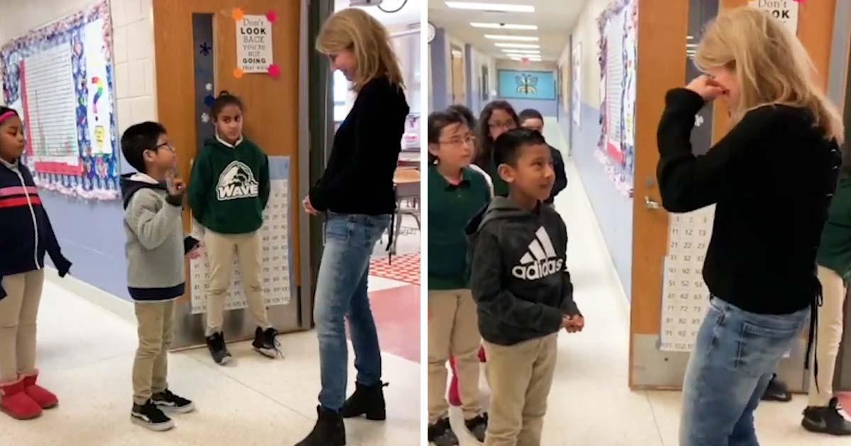 kids-greets-deaf-teacher-using-sign-main