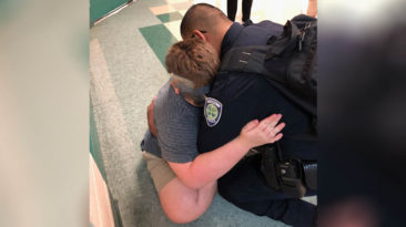 school-rescue-officer-comforts-autistic-boy